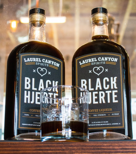 Black Hjerte (heart) liqueur bottles with glass