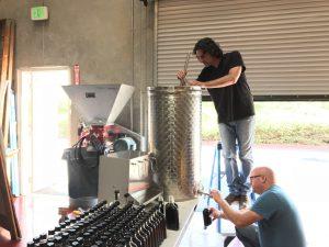 Nathan stirring Black Hjerte (heart) at distillery